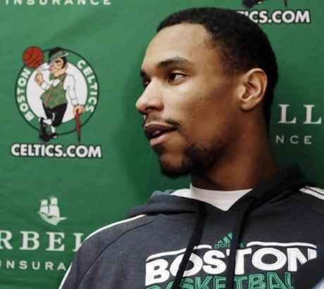 Boston Celtics forward Jared Sullinger speaks to reporters about his season-ending back surgery before an NBA basketball game against the Chicago Bulls in Boston, Wednesday, Feb. 13, 2013. (AP Photo/Elise Amendola)